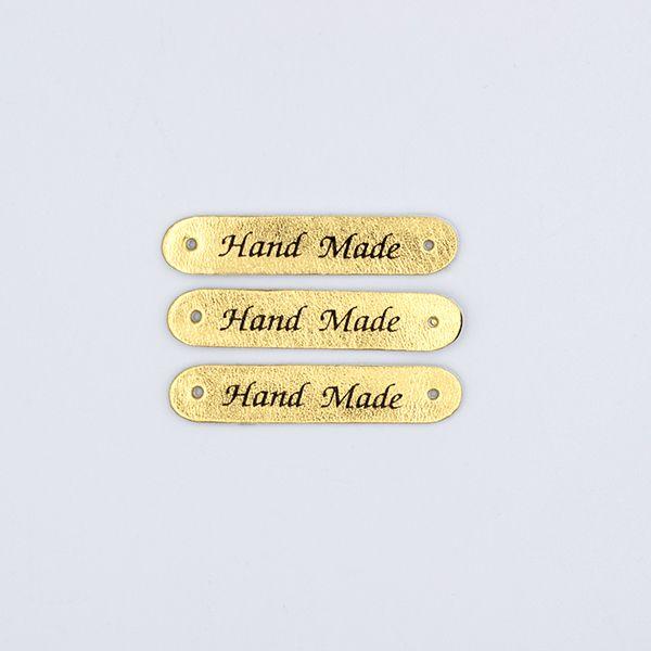 Нашивка кожаная 50×10 mm Hand Made золото