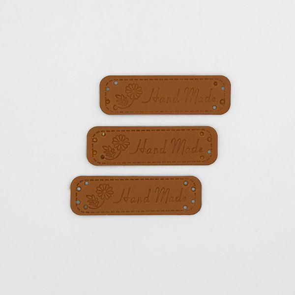 Нашивка кожаная 55×15 mm Hand Made Ромашка коричневая