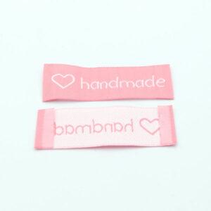 Нашивка тканевая 60×20 mm Hand Made розовая